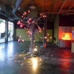 Lit tree art installation in vacant space